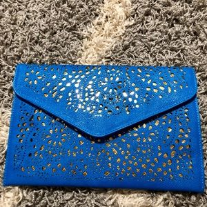 Handbags - Blue and gold clutch